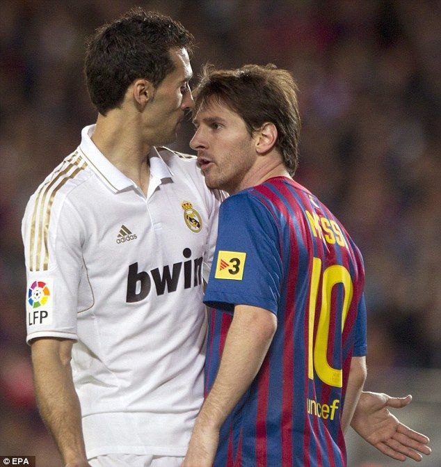 748122bfa3a Arbeloa (left) squares up to Barcelona icon Lionel Messi during an El  Clasico in…