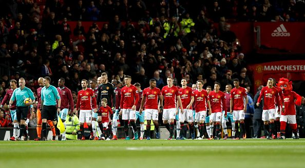 Manchester United And West Ham United Players Walk Out On To The Pitch For The Match During The Premier Manchester United Manchester Manchester United Football