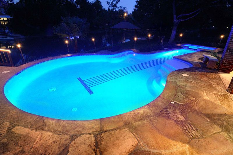 Cool Guitar Shaped Pool At Night Emerald Pools And Spas Inc Sugar Land Texas