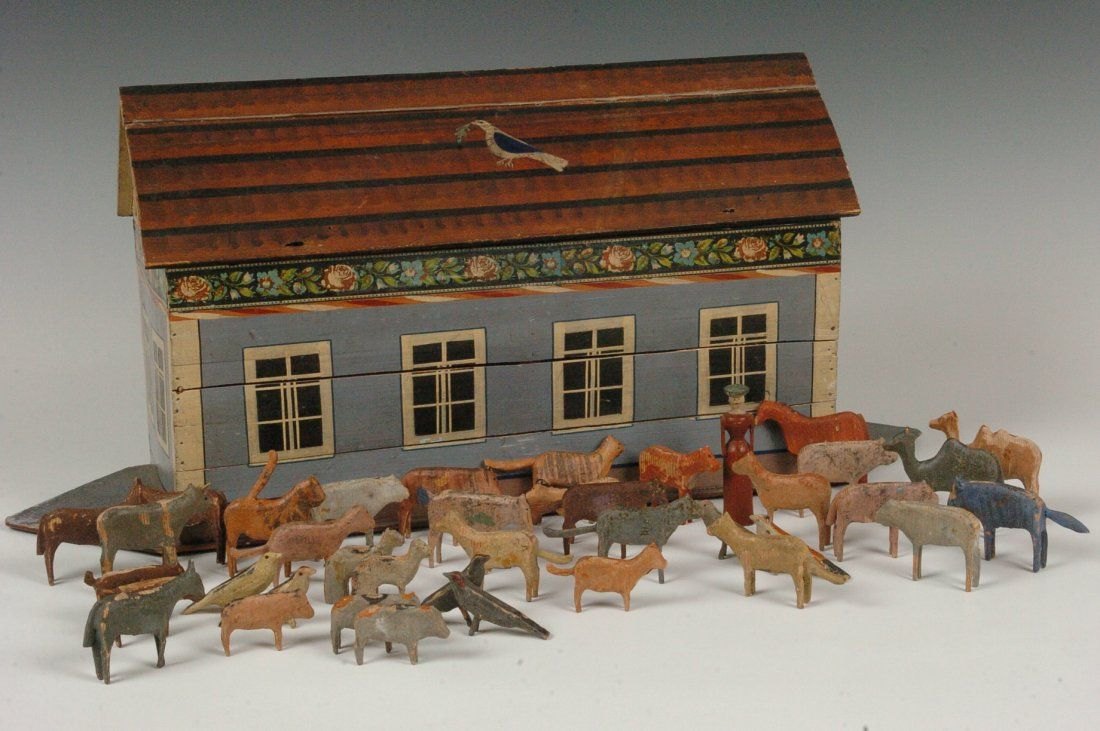 C. 1920'S NOAH'S ARK WITH 60 CARVED WOOD ANIMALS