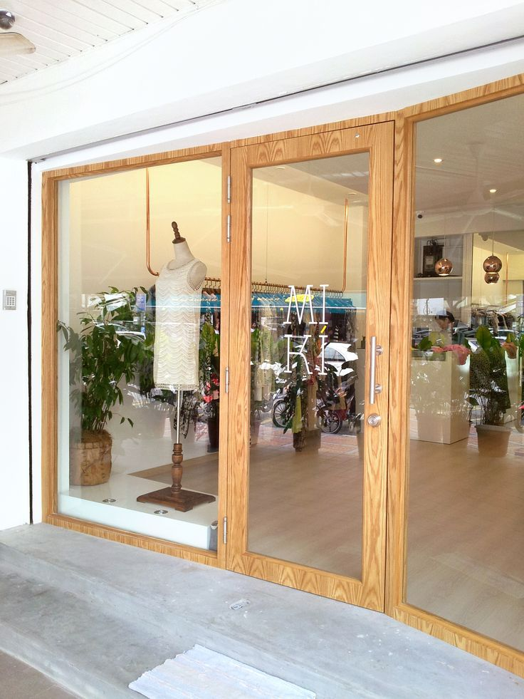 Slanted Glass Panel With Wooden Frame Shop Front Boutique Branding
