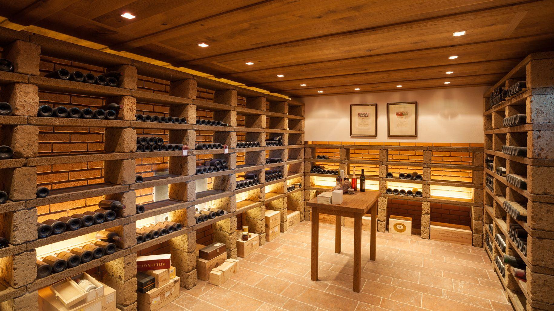 Alpine Estate In Adnet Salzburg Austria This Modern Hillside Estate Boasts A Spectacular Wine Cellar Built In Red Brick Weinregal Ziegel Regal
