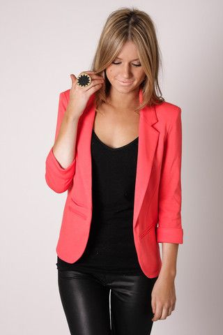 Love this pop of coral on the all black outfit, complete with leather pants.