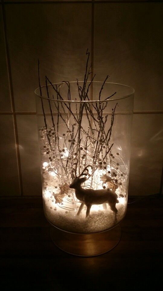 i took a vase fake snow a white glimmer reindeer some silver tree branches and some white pearl and flower decorations and some white christmas lights