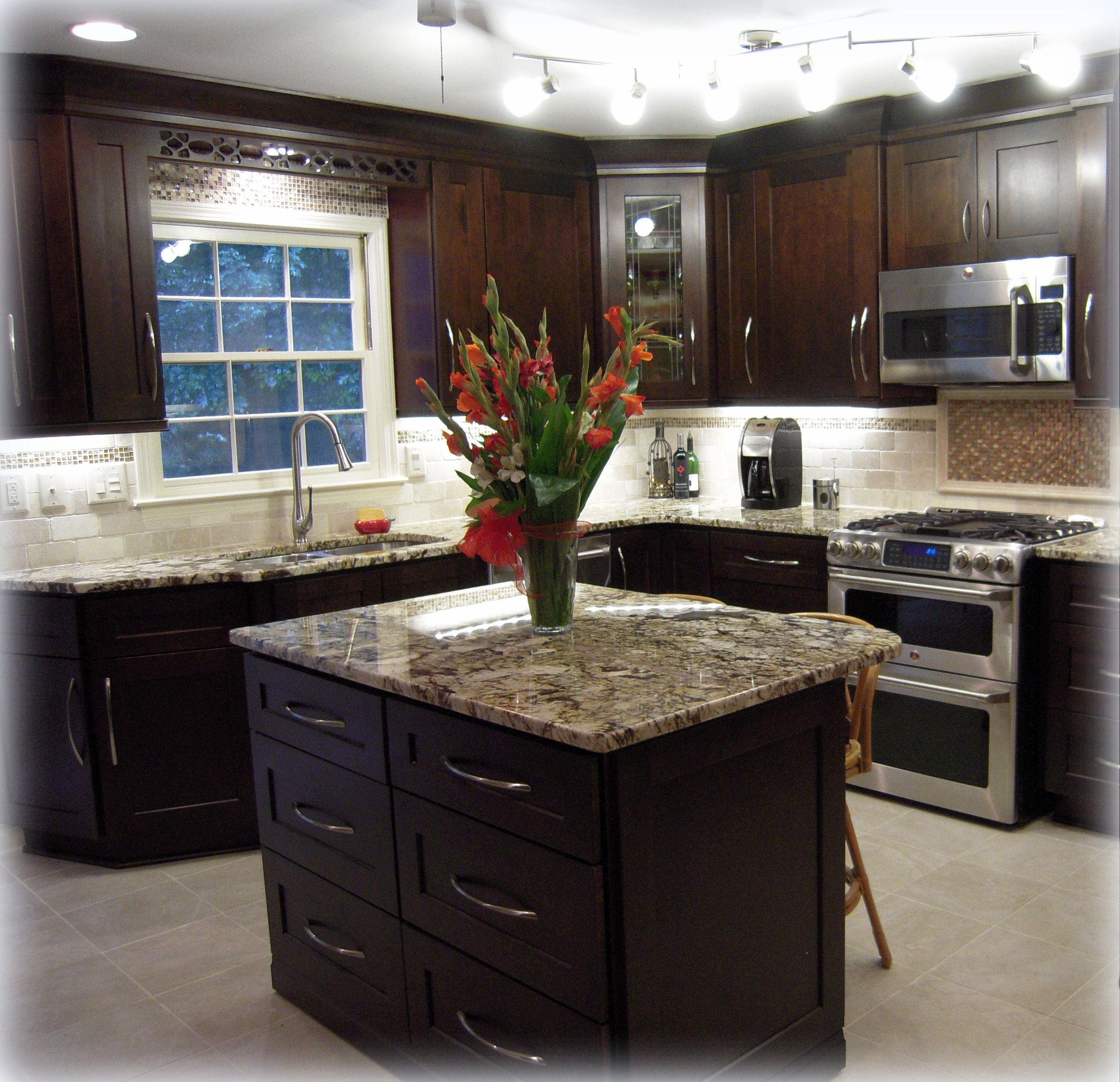 backsplash lighting kitchen cabinet lights Backsplash Tiles Completed Kitchen Mocha Maple Shaker Cabinets Exotic Granite Countertops Track Lighting And Under Cabinet Lighting