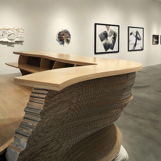 From Edward Cella Art Architecture Ecaa This Interior Separator Made Out Of Cardboard Surpasses The Reception Desk Design Desk Design Unique Reception Desks