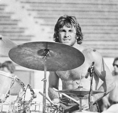 Dennis Wilson - drummer and harmony singer in the Beach Boys. Initially lacking musical talent, the middle Wilson brother was put on drums to fill out the band. Over time, however, he became competent behind the kit and developed into a fine vocalist.