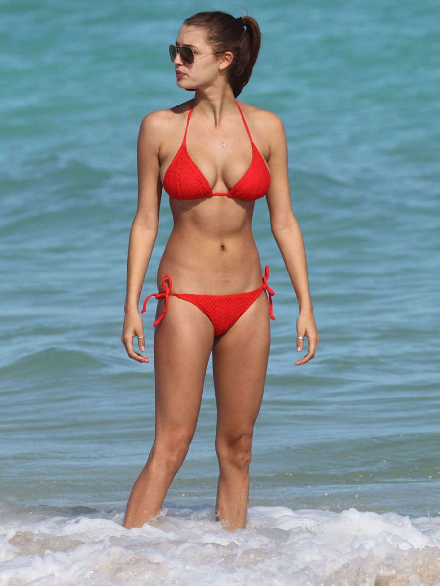 With her thin body and Regular brown hairtype without bra (cup size 34D) on the beach in bikini