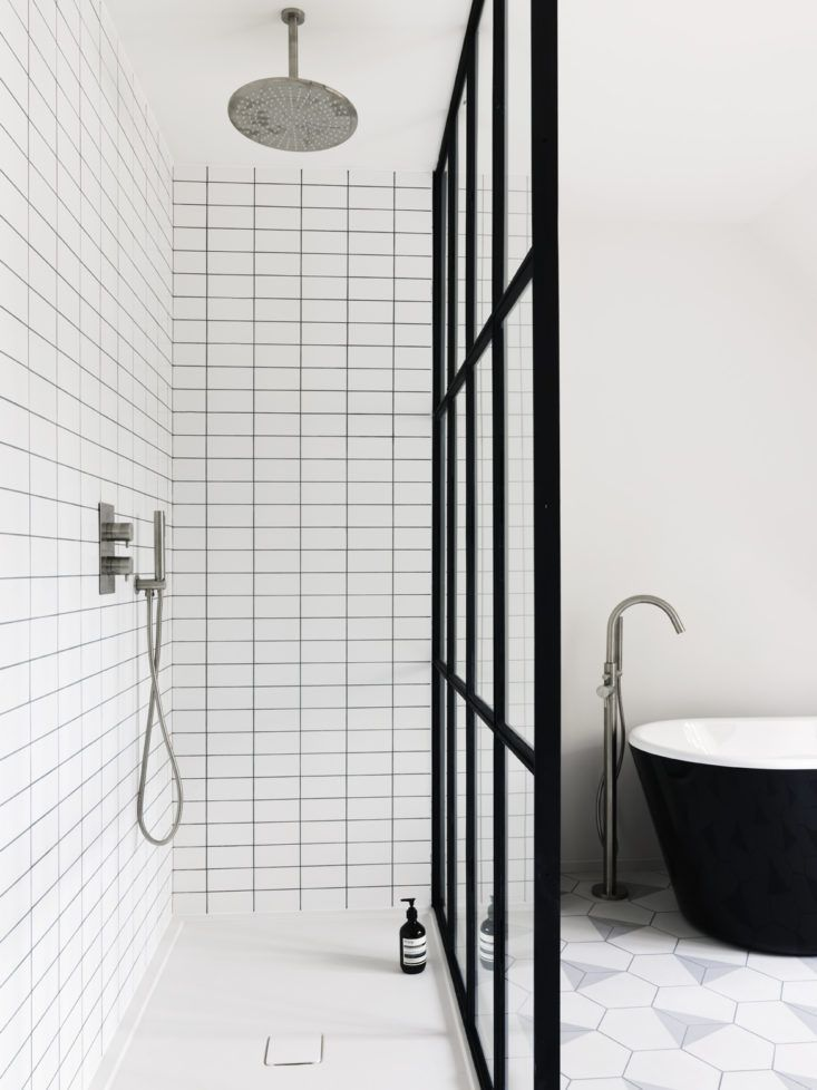 Steel Framed Shower Doors Provide An Open Bathroom Concept. The Use Of  Hexagonal Floor Tiles And A Low Threshold Floor Is Sleek And Modern