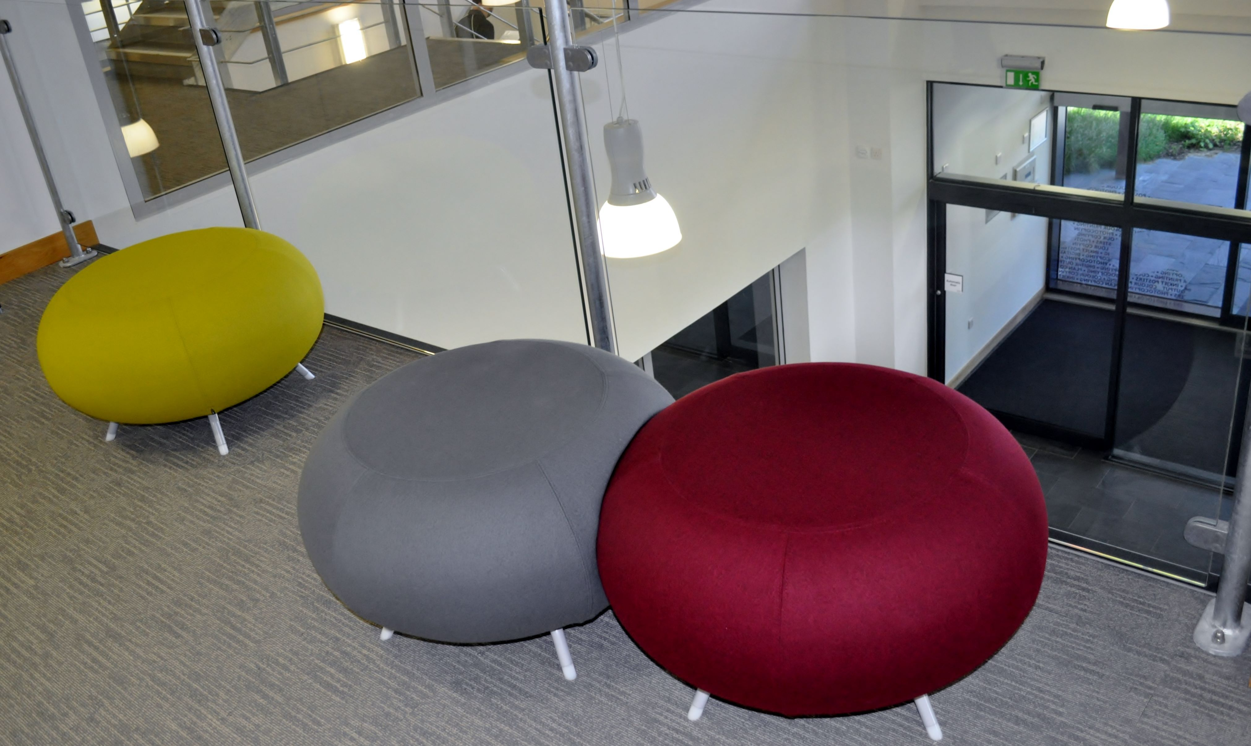 """""""Pebble"""" stools at the Mezzanine area above atrium of the St Austell Print Company's Head Office at the £6.2 million eco-business park in St Austell. Interior scheme by Spinriver Design ltd, Newquay."""