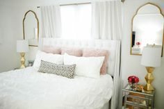 bedroom decor, interior design with Havenly, haute off the rack, home decor, mirrored nightstands, white bedding, pintuck duvet, gold ripley lamps, gold mirrors, faux fur pillows, blush pillows, spotted lumbar pillow, glam style, all white room, white headboard, tufted headboard,
