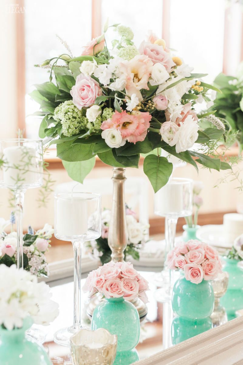 perfect pink floral centrepiece with aqua votives and mirrored