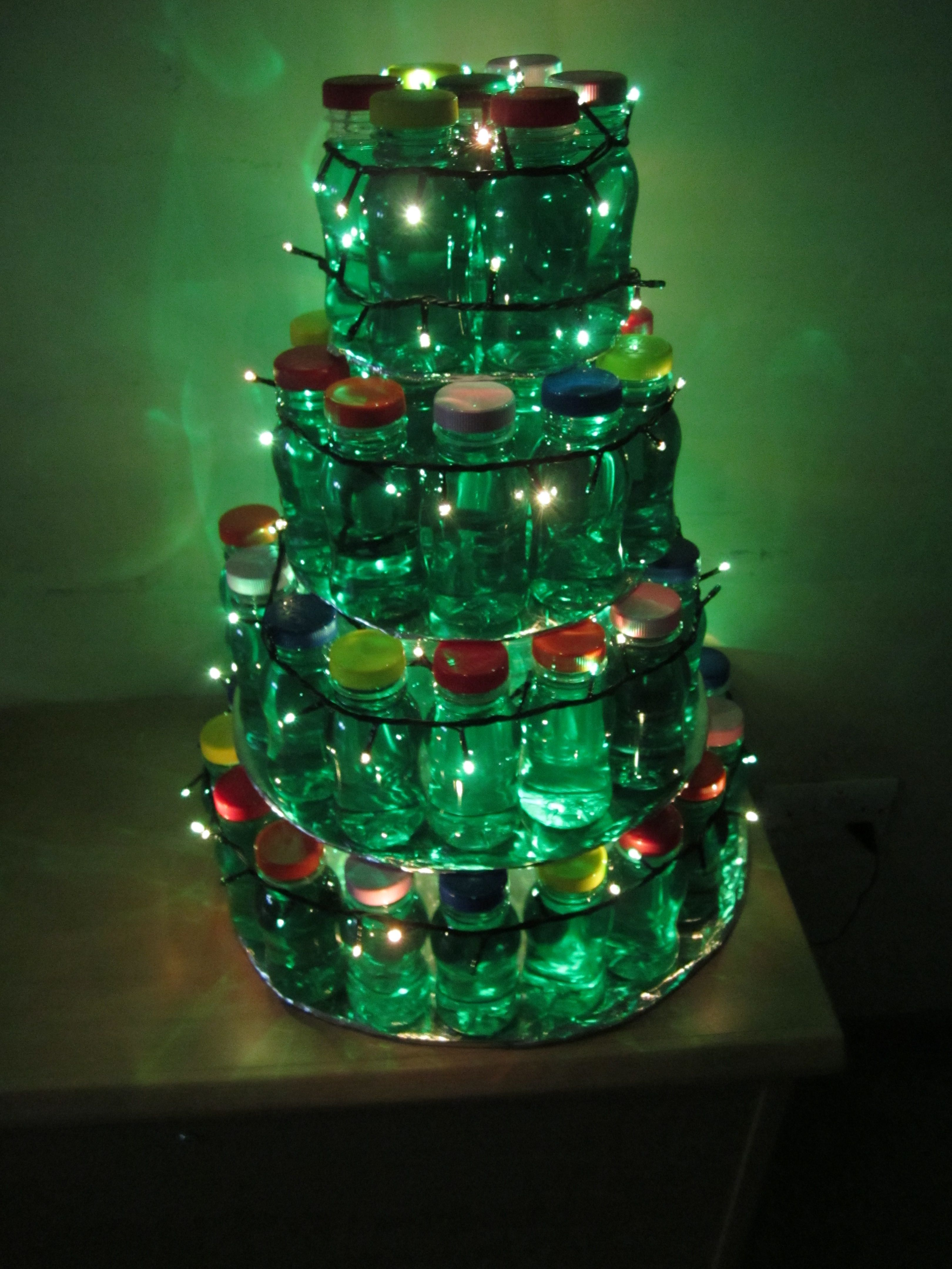 I made this christmas tree out of milk bottles filled with green ...