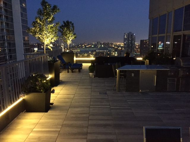 Gorgeous Evening View Of The City Atop A Porcelain Paver Roof Deck Elevated On Pedestals Roof Styles Outdoor Paving Roof Cost