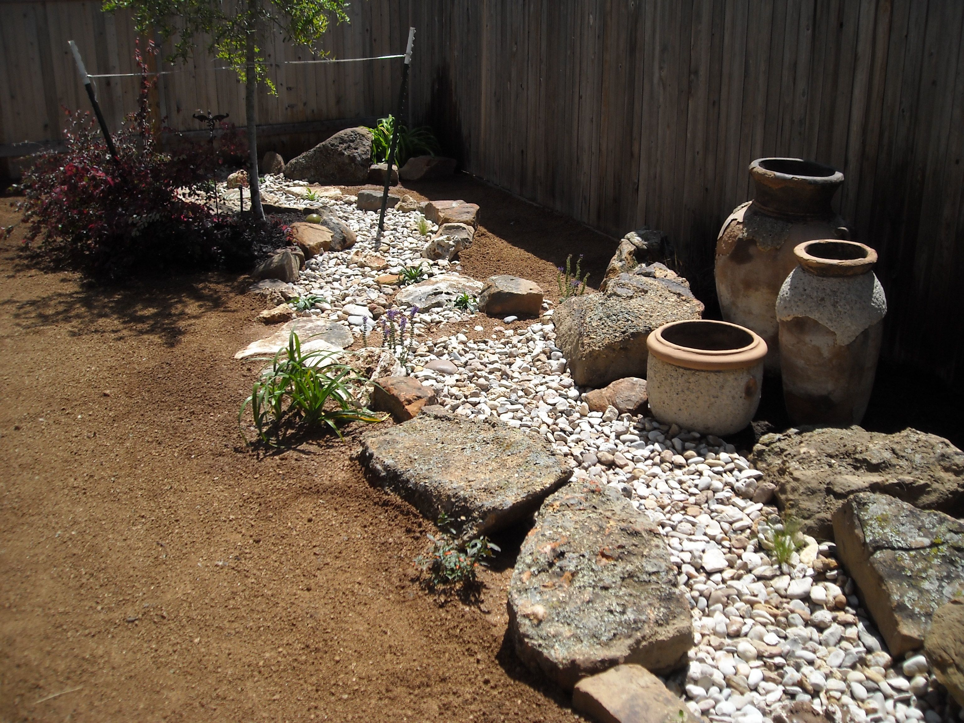 dry creek bed with cool planters