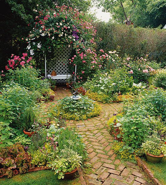 Replace Turf: In this lovely garden, the grass lawn was removed and replaced with a brick path that divides a quartet of small borders. A smaller fifth bed with sundial sits in the center, and a rose covered arbor and bench act as a romantic focal point. From BHG
