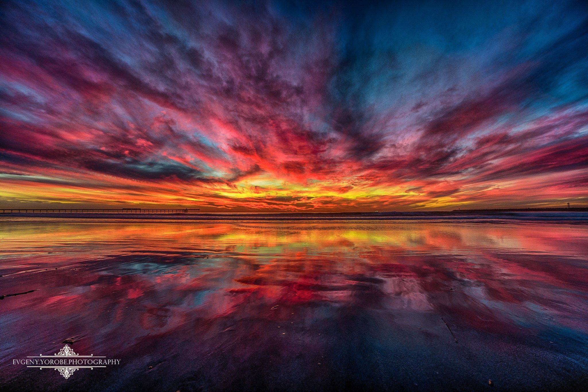 Tonight's insanely colorful sunset shot from Dog Beach in OB at low tide, 12/15/13. The OB Pier can be seen on the left and the jetty on the right.  Photo by Evgeny Yorobe Photography