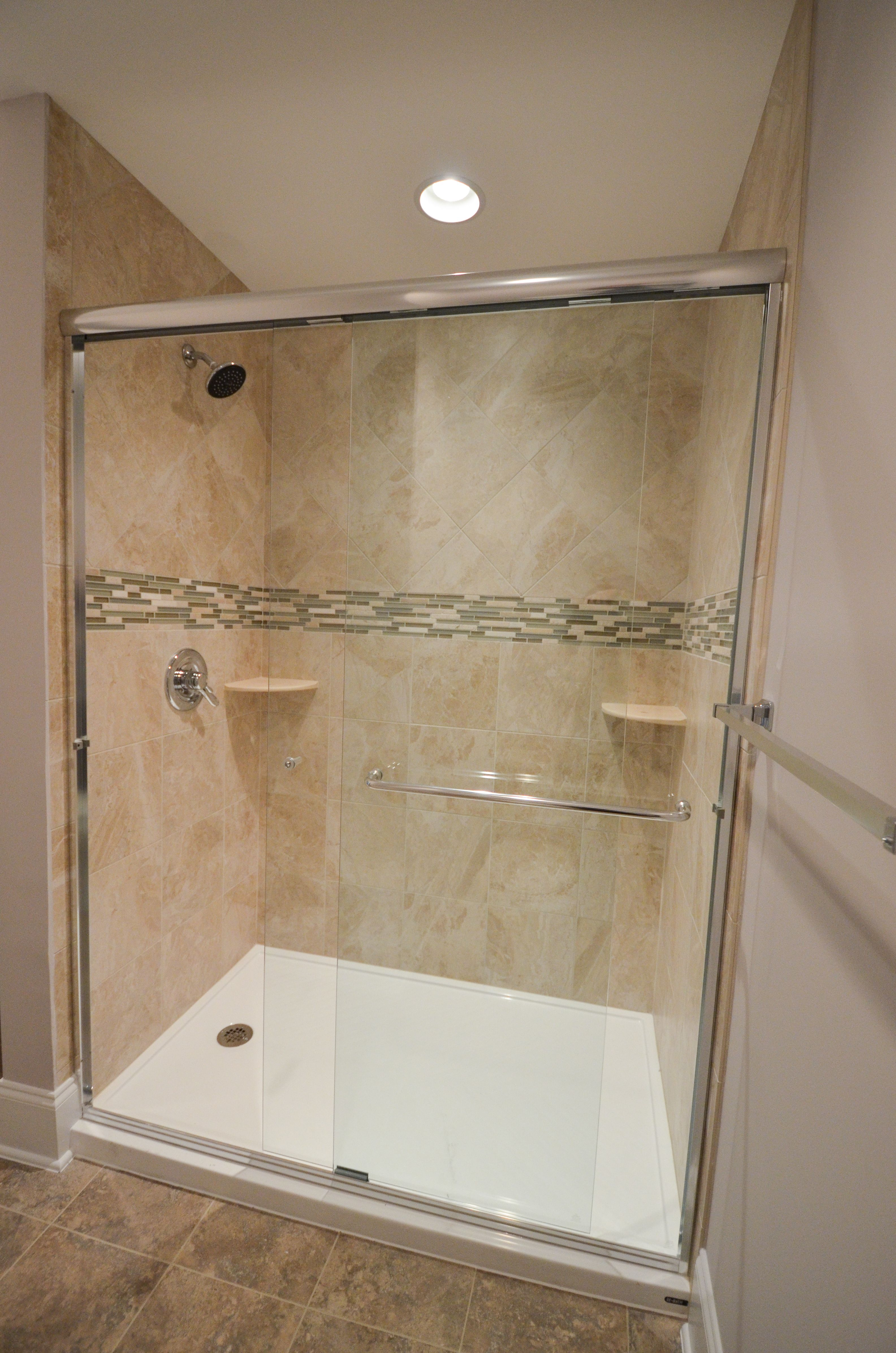 Glass walk-in shower with tile feature strip for a pop of color ...
