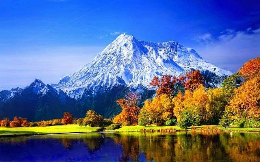 autumn mountain blue sky tree orange snow lake nature