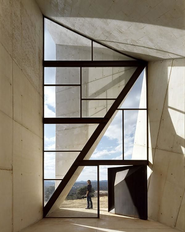 Designed by architecture office S.M.A.O the Chapel of Valleacerón is a stunning minimalist folding concrete structure whose shape emphasizes on symbolism.