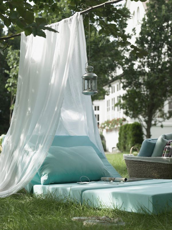 Outdoor Reading Nook.  I love this -- looks so relaxing and fairly easy to do.  Sew cushions, string a sheet over a branch or some rope.  What to use to prop up cushion?