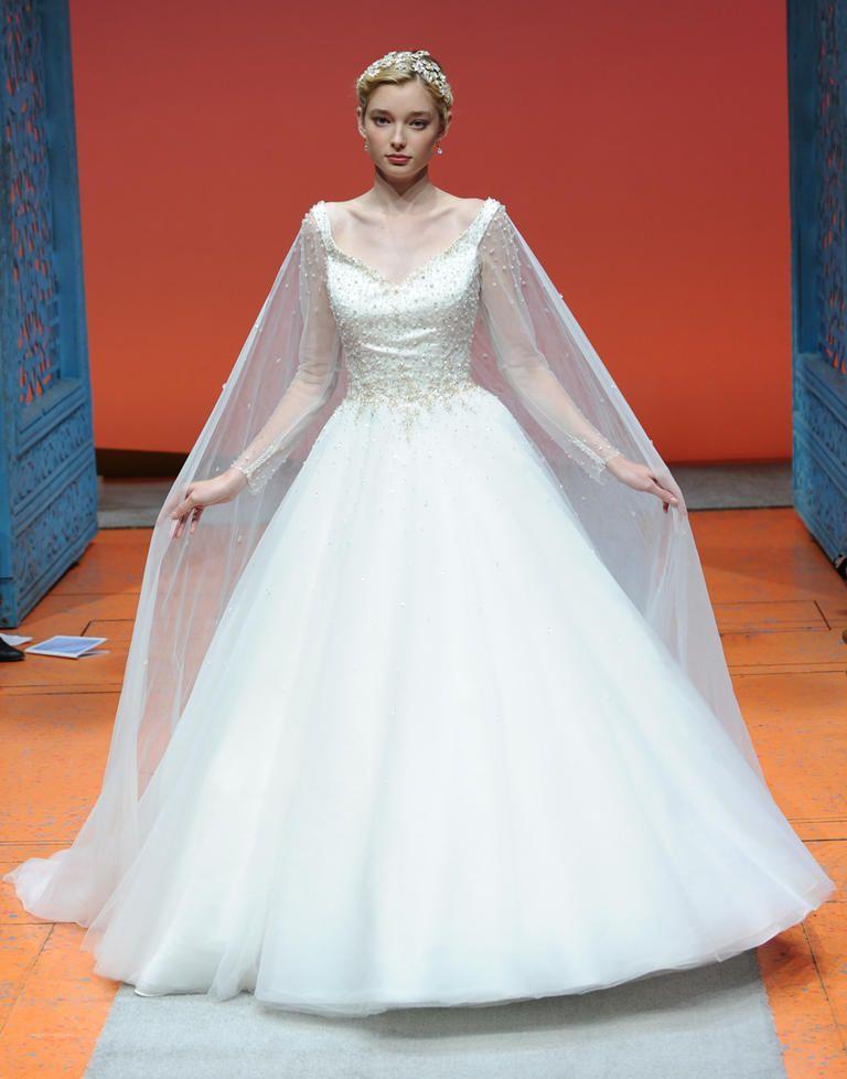 See disney fairy tale weddings by alfred angelo 39 s wedding for Disney line wedding dresses