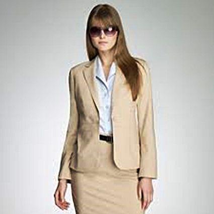 Lady wearing a gorgeous beige suit. http://www.formalworkattire ...