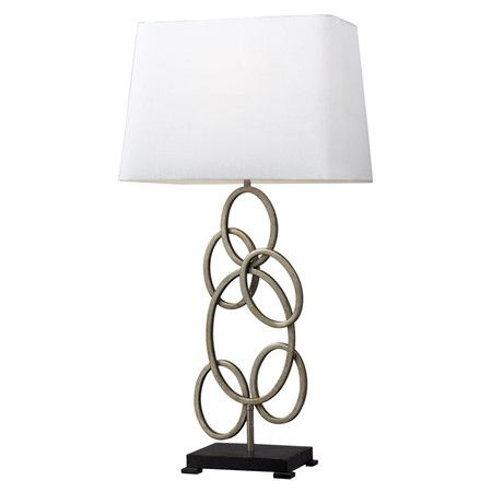 Steel table lamp with a silver-finished concentric circle base.      Product: Table lamp   Construction Material: S...