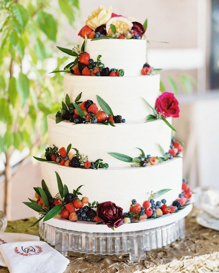 Fresh flowers and berries surrounded the cake. Simple white wedding cake