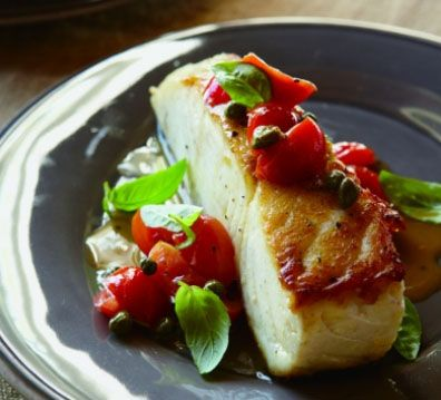Halibut with pepitas, capers and tomatoes | HellaWella