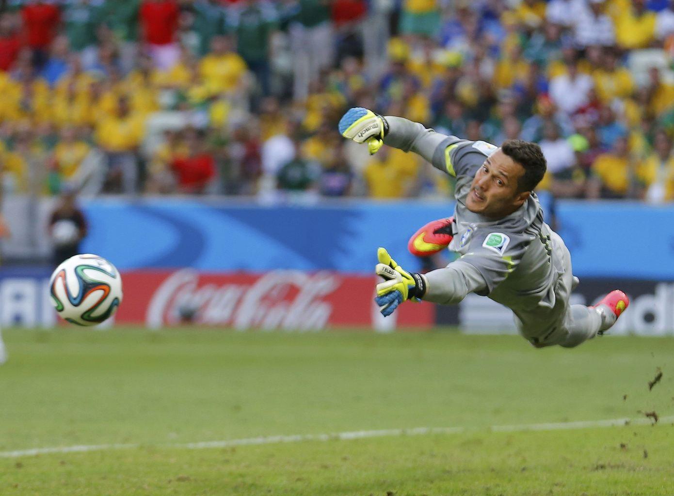 Brazil's goalkeeper Julio Cesar dives for the ball during