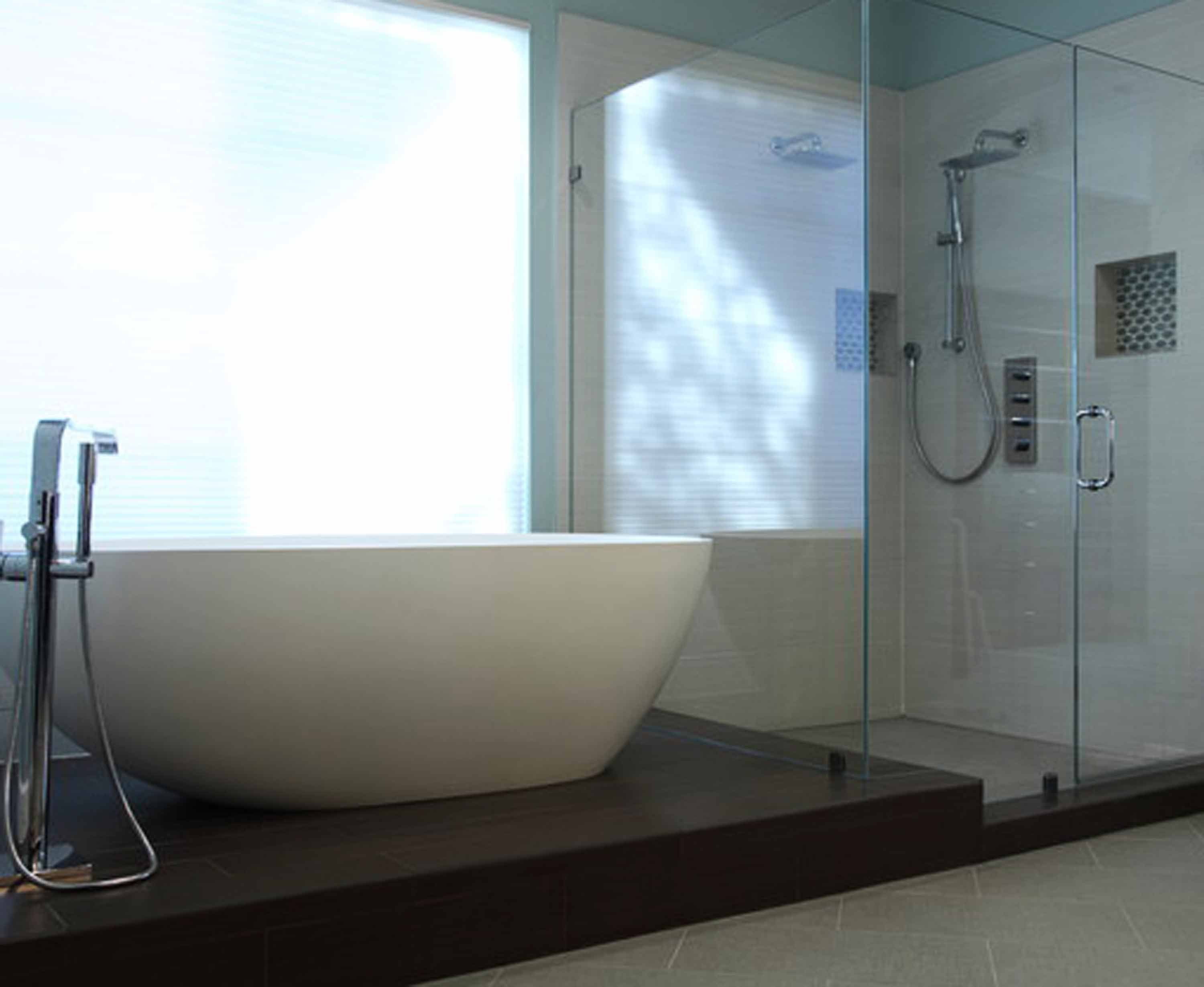 Contemporary Bathroom Standalone Bathtub Stainless Steel Faucet Handheld Glass Shower Cabin Separated Walls Handle Ceramic Flooring Tile Gray Wall Paint
