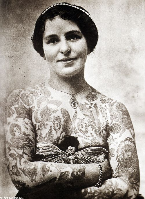 Edith Burchett, London c. 1920  Edith Burchett was the wife of tattoo artist George Burchett. Her husband tattooed her and also did two life size paintings of her.