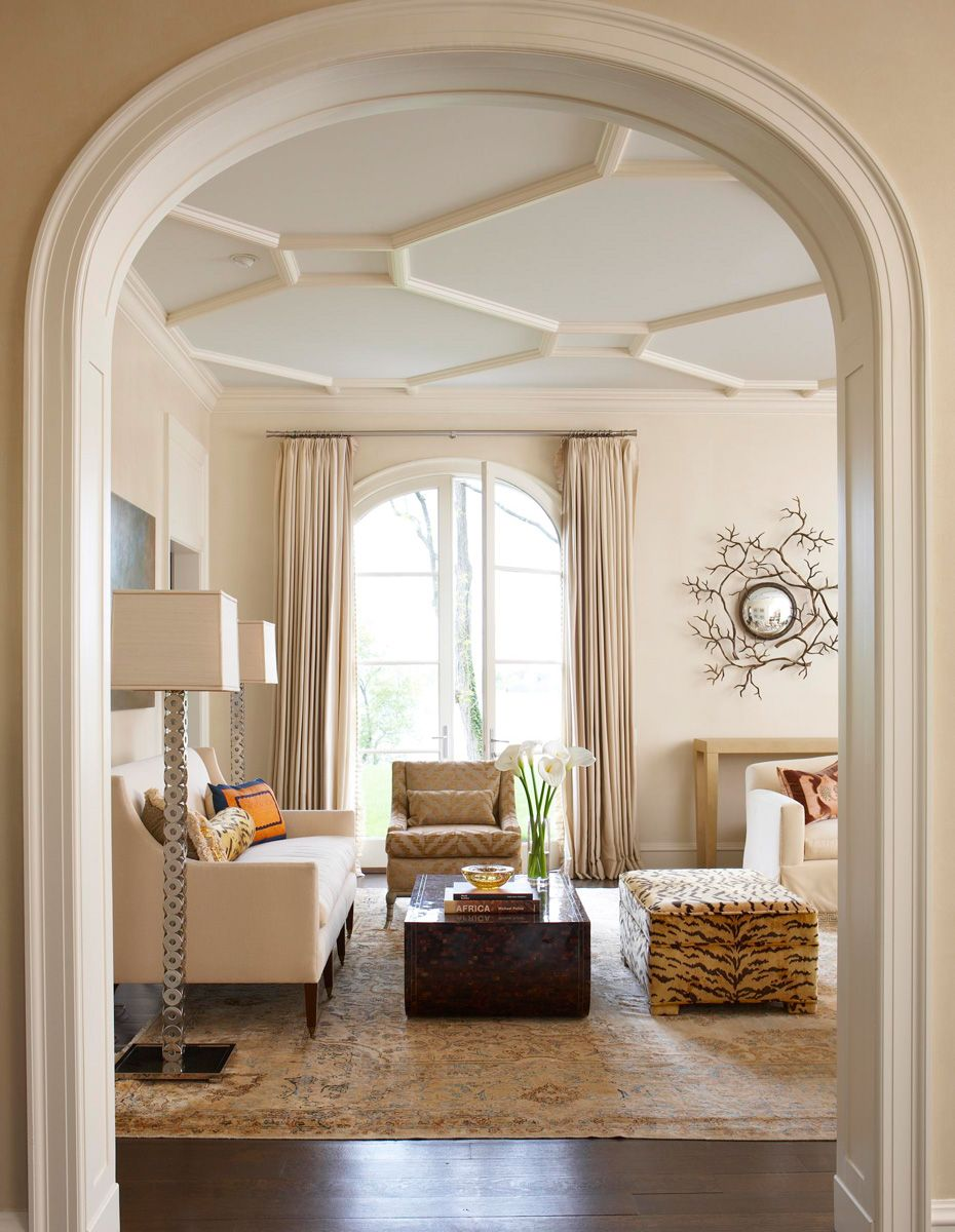 wood-ornamented ceiling and a 19th-century rug dress this living ...