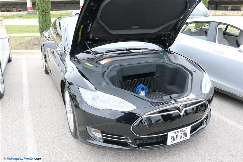 Tesla Model S - member of local owner club humorous hamster wheel . As seen the the April 13 2014 Cars and Coffee in Austin TX USA.
