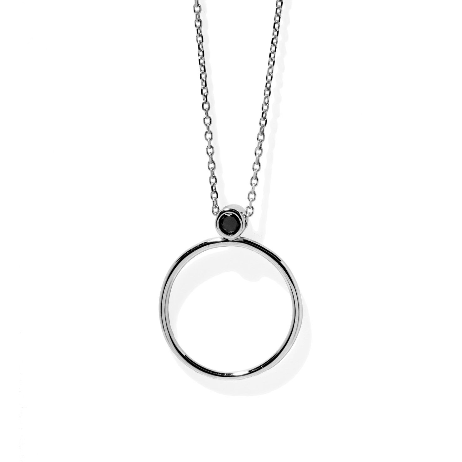 Timeless necklace featuring an open circular pendant with a single