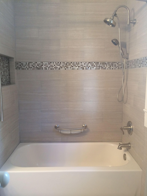 Tile tub surround. Gray tile around bathtub. Grey tile