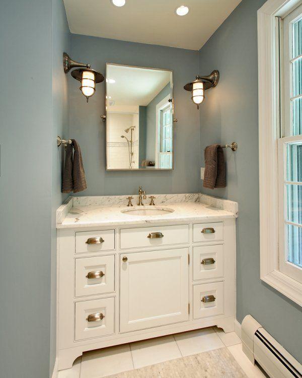 Blue walls, brushed nickel hardware pulls, marble