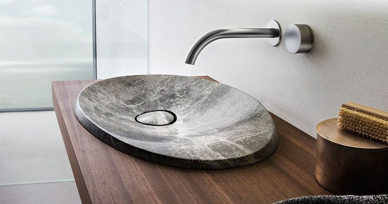 the design of this natural stone sink is inspired by the shape of rh in pinterest com