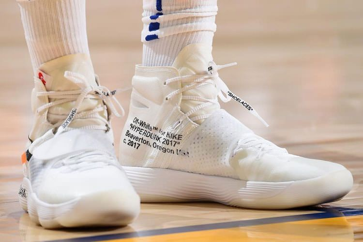 f2536d67ac411 Off White x Nike React Hyperdunk 2017 The Ten sneaker adopted a pure white  flyknit upper, and added strap design, with black, orange and red  composition ...