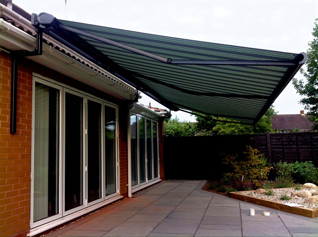 The Markilux 5010 patio awning with custom gutter brackets fitted