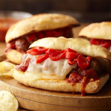 Cozy Italian Slow Cooker Recipes...  Fire-Roasted Tomato and Italian Sausage Grinders  ( made something like this on Cabatta Rolls one night, boy where they yummy! I cooked meatballs in spagetti sauce, then made a Mayo/ horseradish sauce to go on one side of bun with carmelized onions and provolone) Tasty!