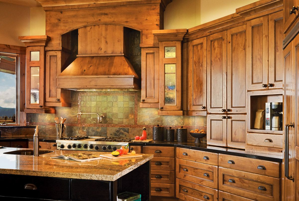 This Inviting Kitchen Highlights Its Beautiful Wood Cabinetry With Complimentary Bronze And Black Ac Pine Kitchen Cabinets Rustic Kitchen Cabinets Pine Kitchen
