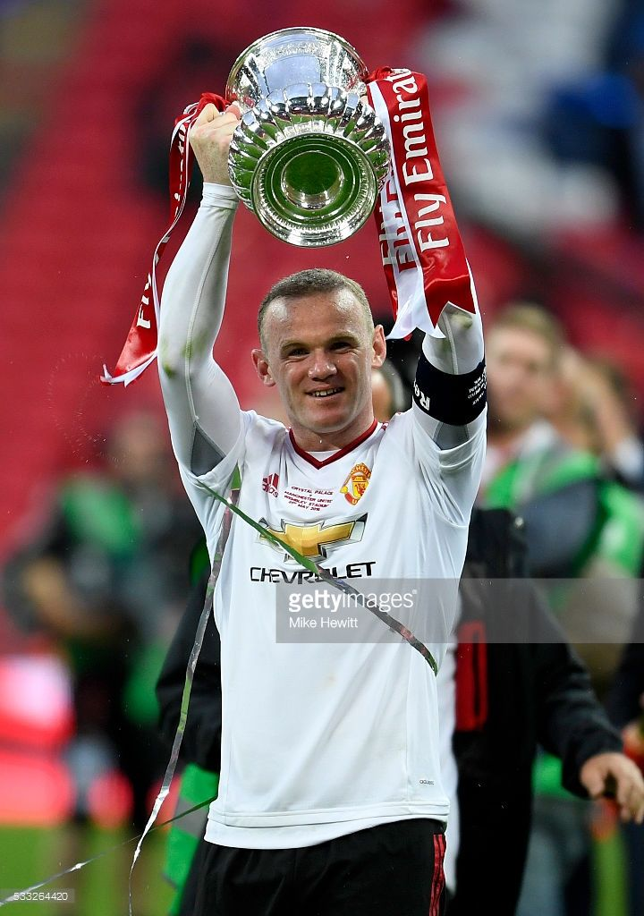 Manchester united v crystal palace the emirates fa cup final wayne rooney of manchester united celebrates with the trophy after winning the emirates fa cup final voltagebd Image collections