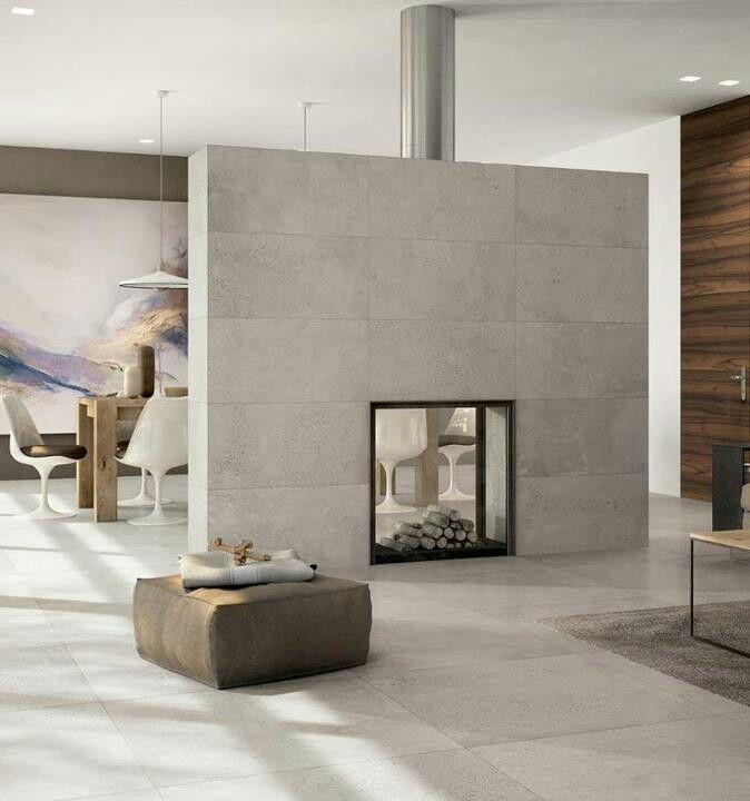 modern fireplace zwischen wohnen und essen wandgestaltung kachelofen modern bodenplatten betonwand fliesen