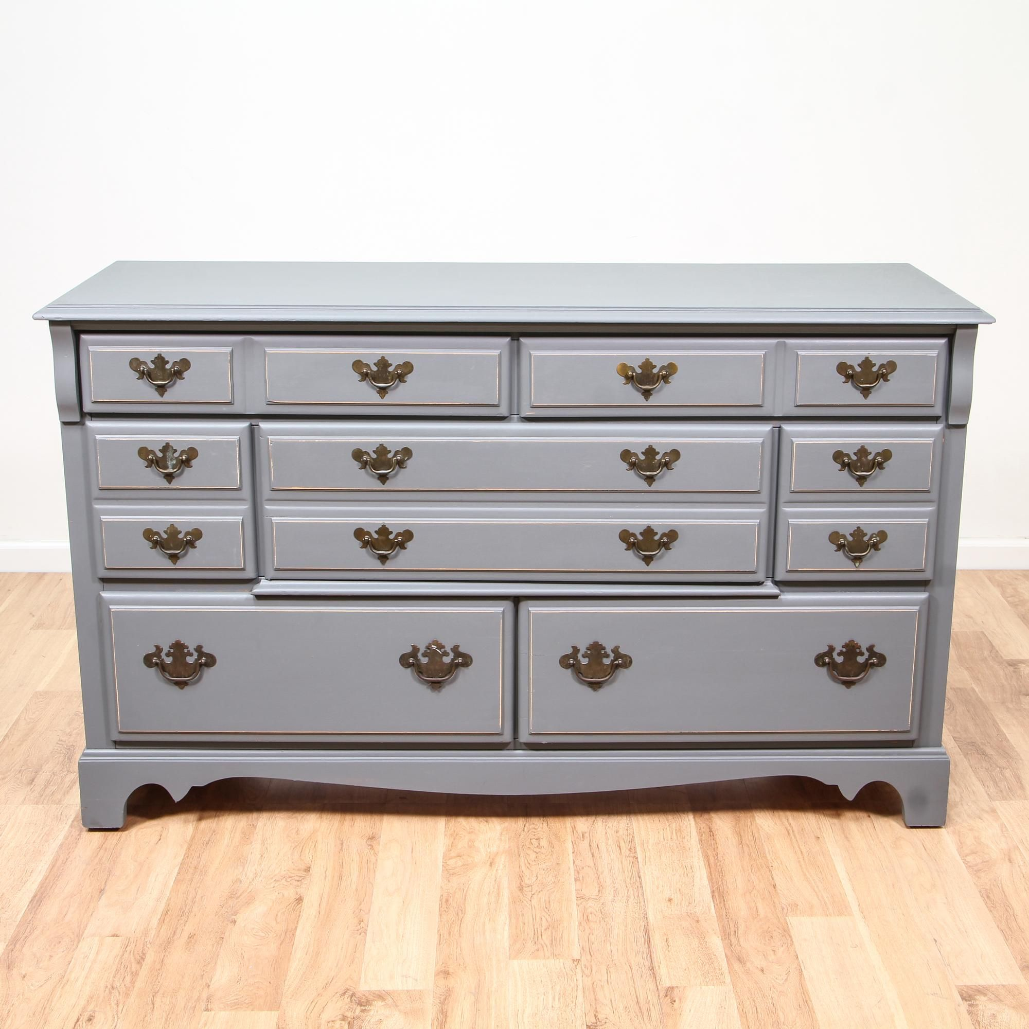 This shabby chic dresser is featured in a solid wood with a