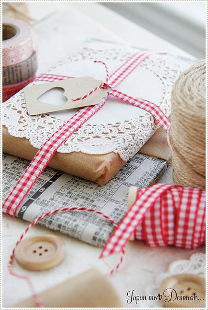 Wrapping with brown paper, gingham ribbon, doilies, buttons and twine!
