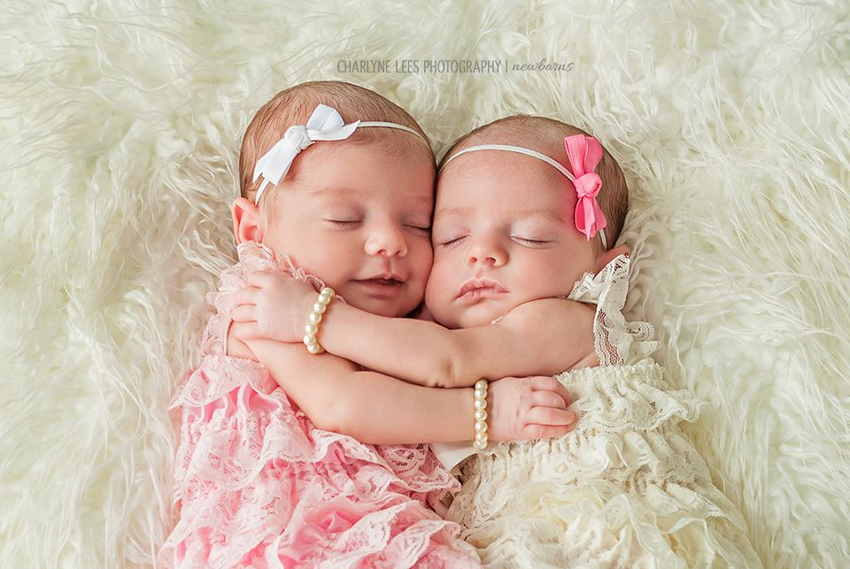 Newborn photography twins vintage inspired beautiful newborn baby twin girls in rompers pearls charlyne lees photography