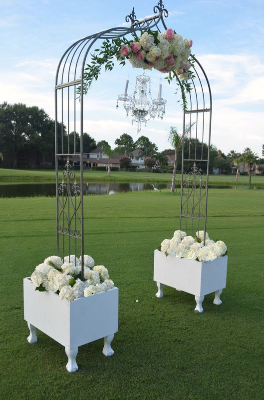 Gothic Wedding Arch Sitting In Planter Boxes To Elevate The Arch