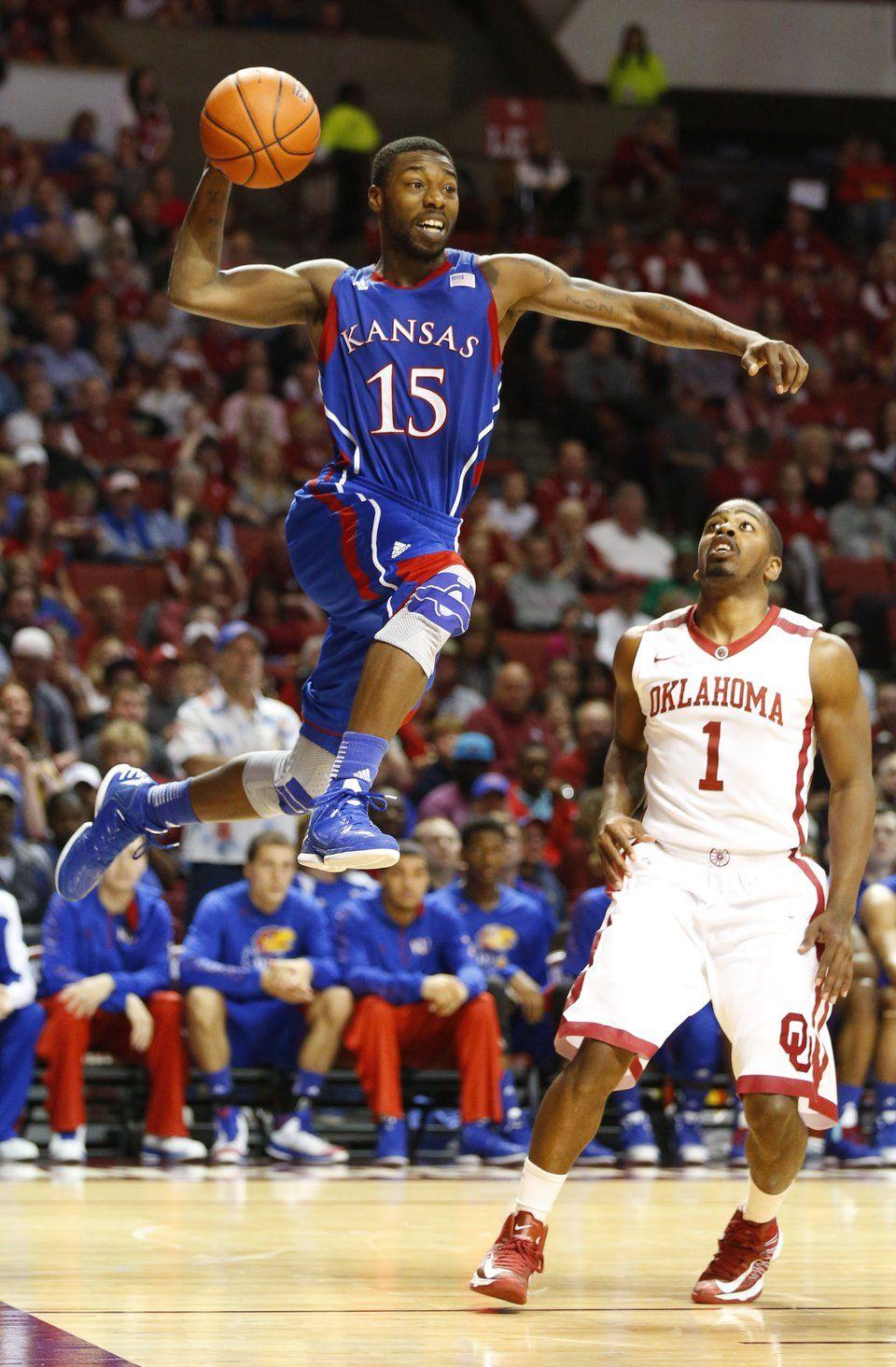 Kansas guard Elijah Johnson soars in for a dunk against